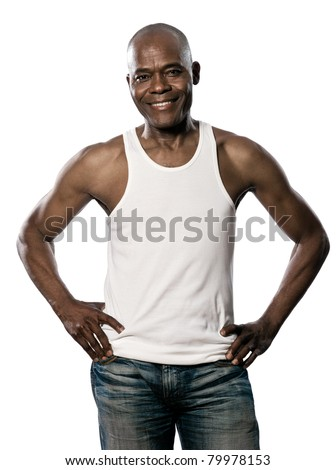 Portrait of a happy afro American man with hands on waist standing in studio on white isolated background