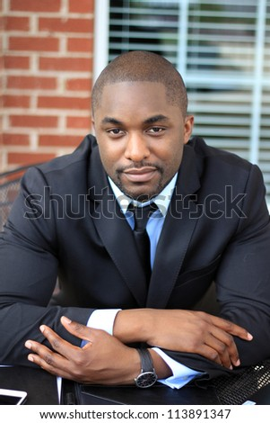 Portrait of a Happy and Attractive Young Professional African American Businessman Working On Paperwork