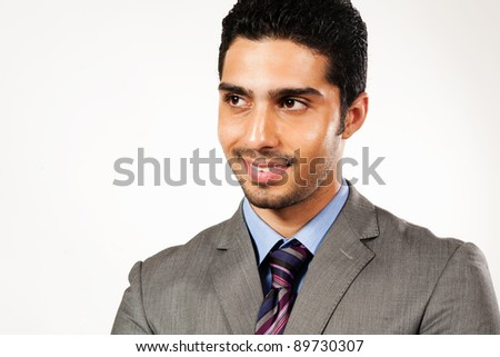 portrait of a happy Arab businessman, biracial businessman isolated on white