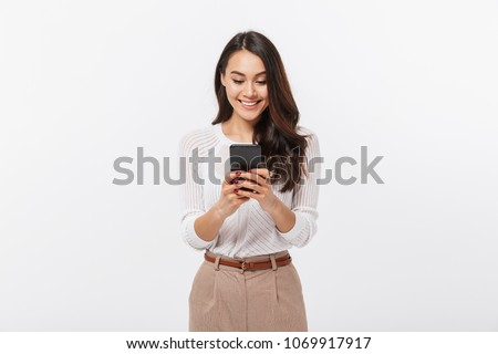 Portrait of a happy asian businesswoman using mobile phone isolated over white background stock photo