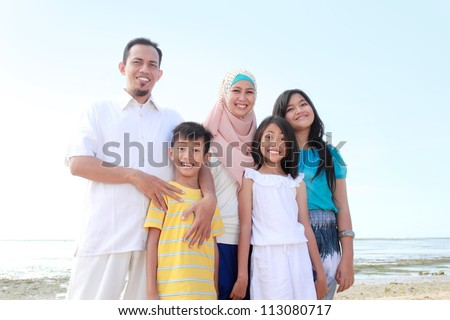 Portrait of a happy asian family on vacation
