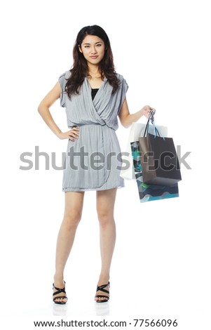 Portrait of a happy Asian woman with shopping bags