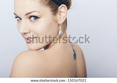Stock Photo Portrait of a happy beautiful women. Studio shot.