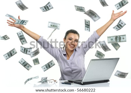 Portrait of a happy brunette woman in glasses with lucky money - dollars coming down like rain
