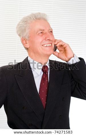 Portrait of a happy business man on a white
