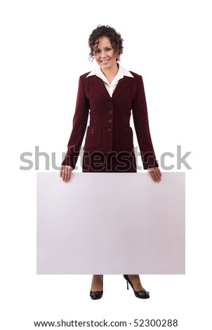Portrait of a happy businesswoman holding white blank card against isolated white background. A beautiful young woman is holding a blank white sign. Business woman standing beside a billboard