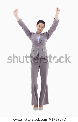 Portrait of a happy businesswoman posing with the arms up against a white background