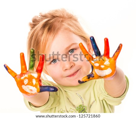 Portrait of a happy cheerful child showing her hands painted in bright colors, isolated over white