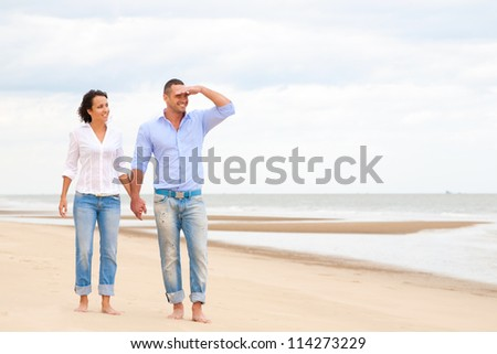 Portrait of a happy couple at the beach