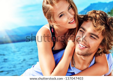 Portrait of a happy couple enjoying vacation on the sea.