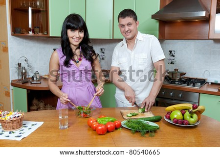 Portrait of a Happy couple preparing food in the kitchen