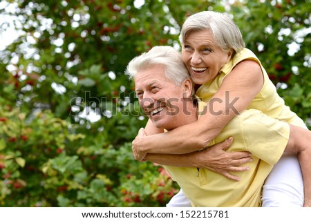 Portrait of a happy elder couple in the late spring outside