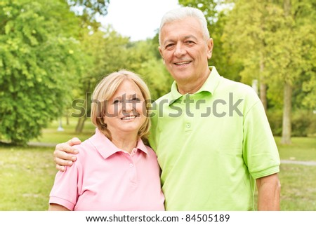 Portrait of a happy elderly couple outside.