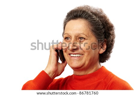 Portrait of a happy elderly woman speaking on mobile phone