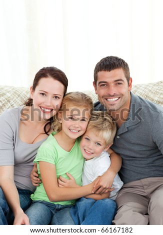 Portrait of a happy family at home sitting in the living room
