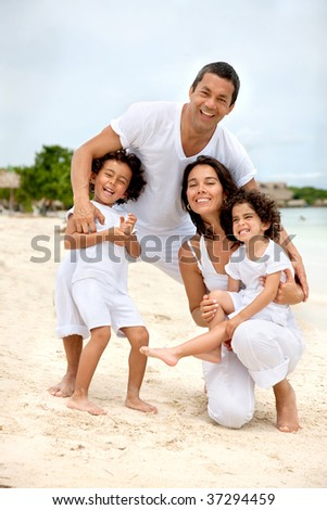 Portrait of a happy family at the beach