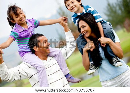 Portrait of a happy family having fun outdoors