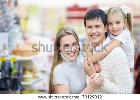 Portrait of a happy family in the store