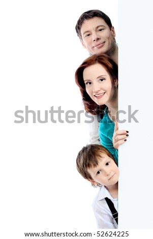 Portrait of a happy family looking out of a billboard. Isolated over white background.