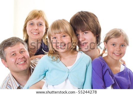portrait of a happy family of five on a light background
