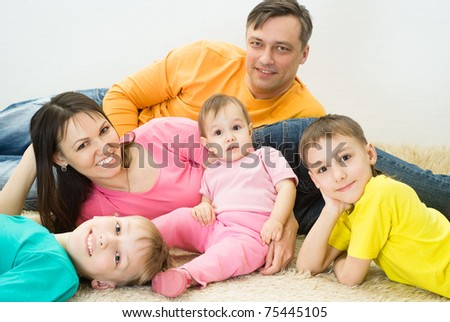 portrait of a happy family of five on white