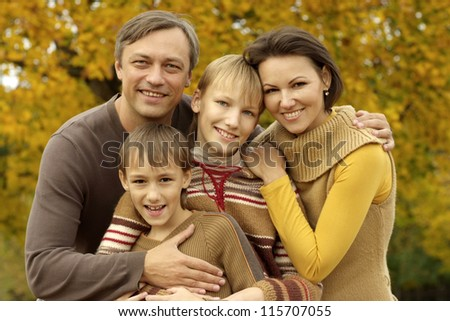 portrait of a happy family playing in autumn park