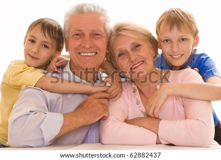 portrait of a happy family playing on a white - stock photo