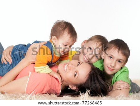 portrait of a happy family playing on carpet