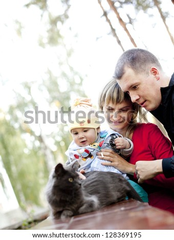 Portrait of a happy family with a house cat
