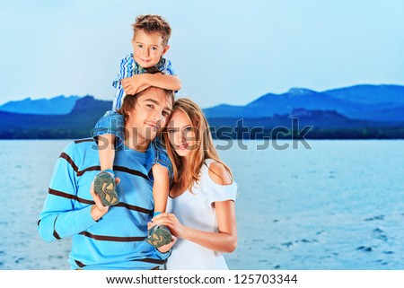 Portrait of a happy family with little son on vacation.