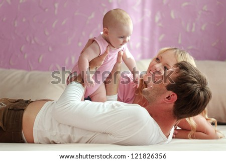 Portrait of a happy family with their baby daughter