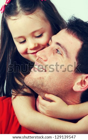 Portrait of a happy father and a beautiful little girl