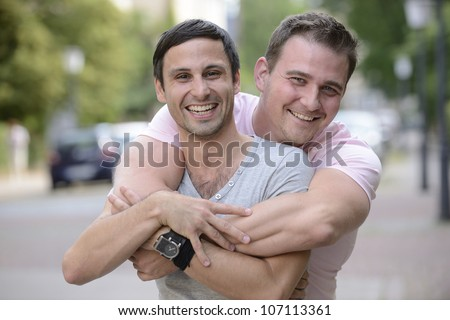 Portrait of a happy gay couple outdoors