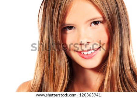 Portrait of a happy girl smiling at camera. Isolated over white.