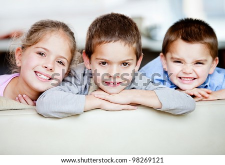 Portrait of a happy group of kids smiling - indoors