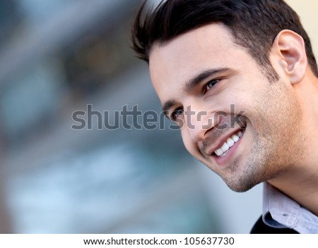 Portrait of a happy handsome man smiling