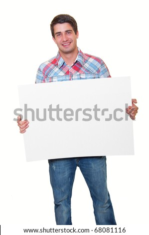 Portrait of a happy handsome young man holding blank white card over white background
