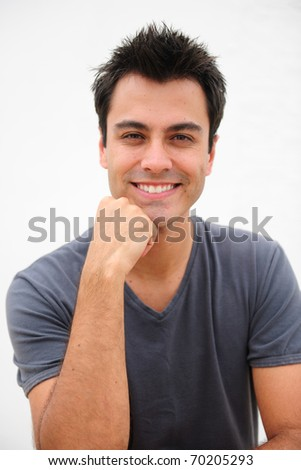 portrait of a happy hispanic man smiling isolated on white - stock photo