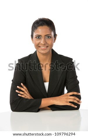 Portrait of a happy Indian business woman. Isolated on a white background.