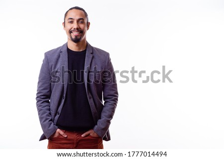 Portrait of a happy Latino businessman man on white background. Successful multiethnic man with hands in pants pockets. Young successful Latino businessman. Copy space. Business concept Stockfoto ©