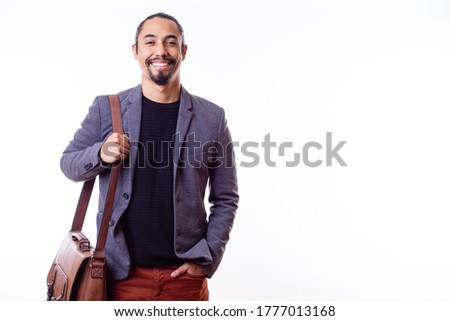 Portrait of a happy Latino businessman man with a leather briefcase and on white background. Young successful Latino businessman. Copy space. Business concept. Stockfoto ©