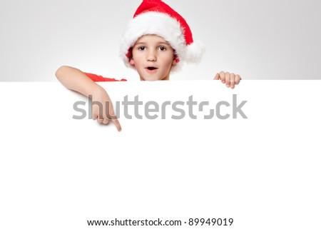 Portrait of a happy little boy holding a blank board