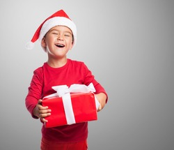 portrait of a happy little boy holding a new gift