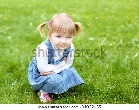 Portrait of a happy little girl in the park