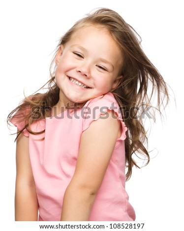 Portrait of a happy little girl, isolated over white