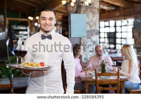 portrait of a happy male waiter ...