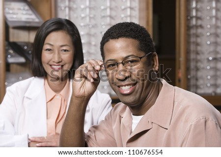 Portrait of a happy man and female optician
