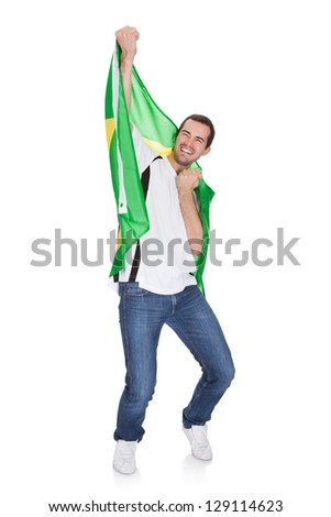 Portrait Of A Happy Man Holding An Brazilian Flag. Isolated on white