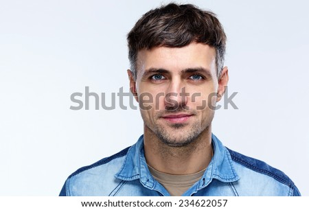 Portrait of a happy man over gray background