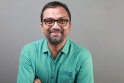 Portrait of a happy middle aged man of Indian ethnicity